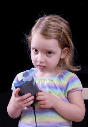 little girl taking a nebulizer treatment to help control her asthma